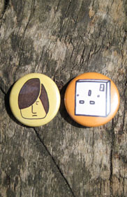 set of 2 badges